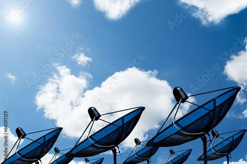 Fotografía  black antenna communication satellite dish on blue sky