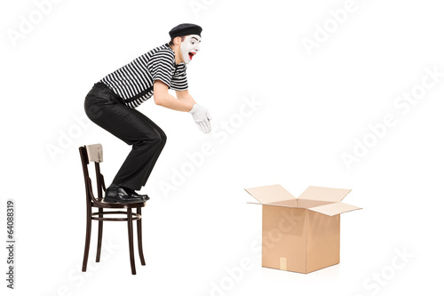 Fotografie, Obraz  Mime artist jumping in an empty box