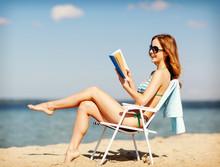 Girl Reading Book On The Beach...