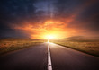 canvas print picture - Road Leading Into A Sunset