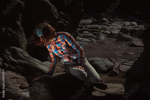 Woman sitting on a rock Canvas Print