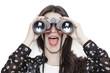 Leinwanddruck Bild Surprised girl looking through binoculars