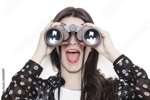 Leinwanddruck Bild - patronestaff : Surprised girl looking through binoculars
