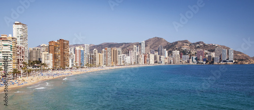 Panoramic of Playa de Levante, Benidorm beach, under blue sky.