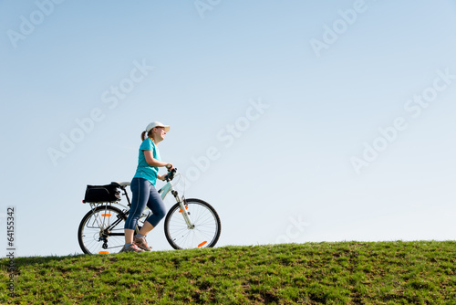 Fotografie, Tablou  woman cycling outdoors