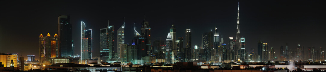Panel Szklany Dubai. World Trade center and Burj Khalifa at night