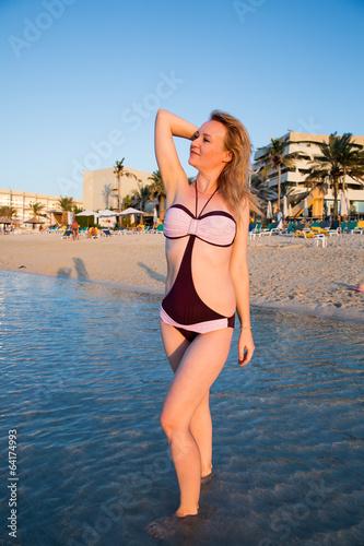Fotografie, Obraz  Beautiful woman on background of beach. Persian Gulf ,Dubai.