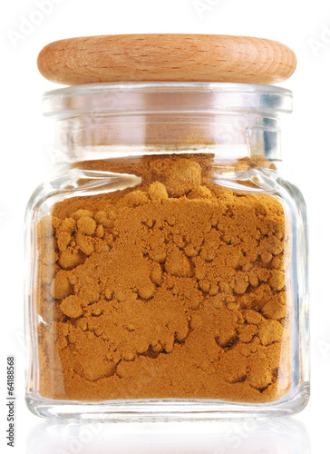jar with spice isolated on white