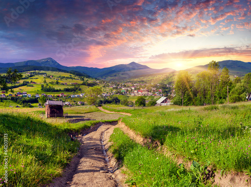 Poster Lime groen Beautiful summer sunset in the mountain village