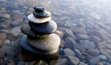 Zen Balancing Rocks On Pebbles Covered With Water