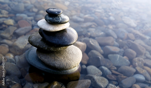 Stampa su Tela Zen Balancing Rocks on Pebbles Covered with Water