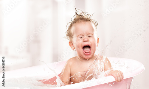 Fotografija happy funny  baby  laughing and bathed in bath