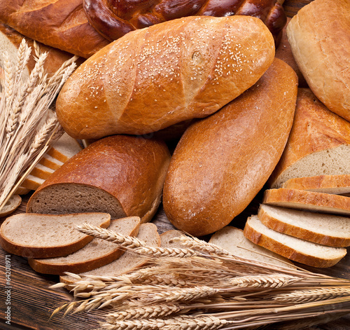 Bread and wheat. Food background. - 64208971