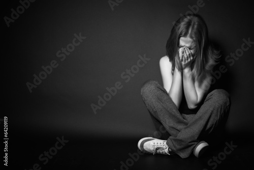 Fotografie, Obraz  woman in depression and despair crying on black dark