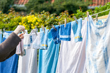 Old Woman Hanging Laundry Outd...