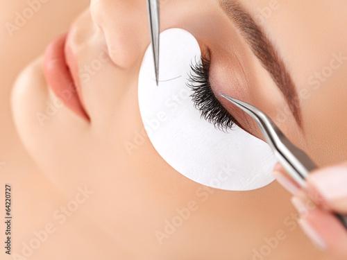 Obraz na plátně  Žena oko s dlouhými řasami. Prodlužování řas