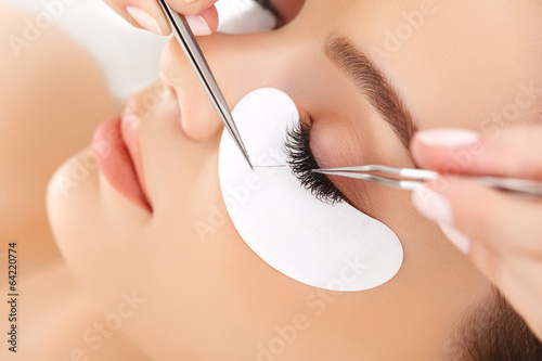 Foto  Woman Eye with Long Eyelashes. Eyelash Extension