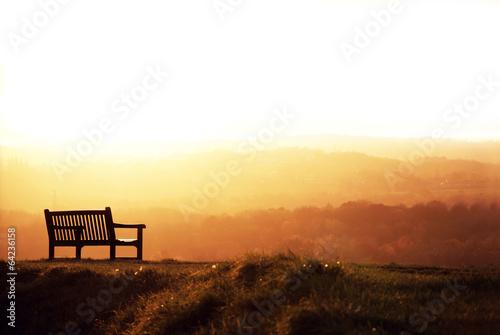 Bench and sundown. Canvas Print
