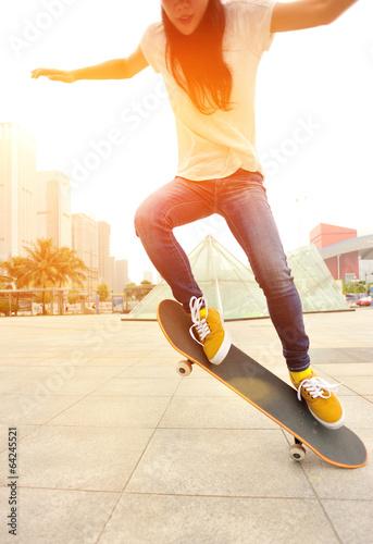 skateboarding woman jump