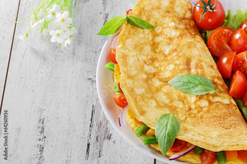 Deurstickers Gebakken Eieren omelet with vegetables and cherry tomatoes