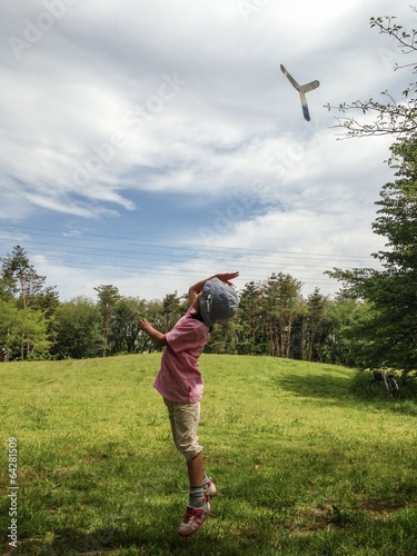 Photo ブーメランを投げる子供