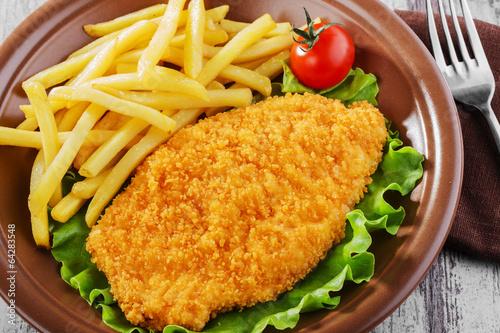 breaded chicken schnitzel fries Canvas Print