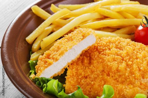 Fotomural  breaded chicken schnitzel fries