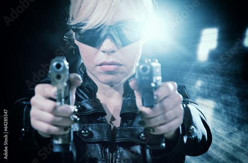 Beautiful sexy girl with gun Fotobehang