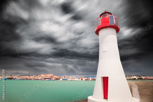 Red lighthouse in the enter of the harbor