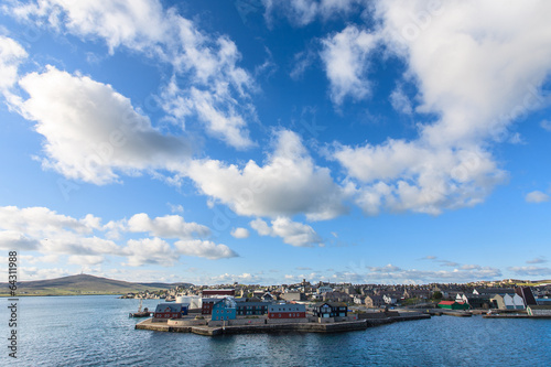 City on the water Lerwick town center under blue sky