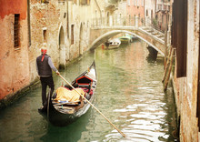 Gondola On Canal In Venice