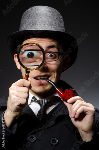 Fotografia  Funny detective with pipe and hat