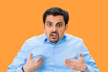 Angry Man Asking You Mean ME? Isolated On Orange Background