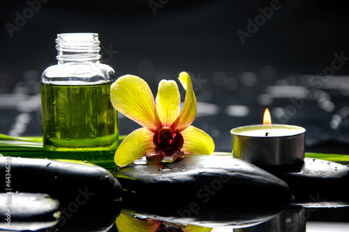 Poster Spa orchid with pebbles and massage oil ,leaf, candle on wet