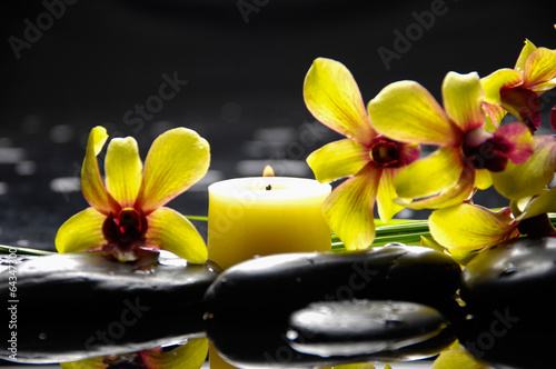 Poster Spa Yellow orchid with yellow candle and therapy stones