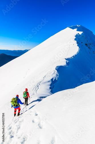 Staande foto Nepal Mountaineers walking on the Kosuta ridge in Karavanke range