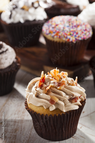Photo  Assorted Fancy Gourmet Cupcakes with Frosting