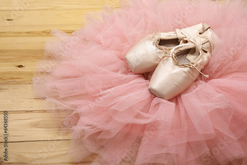 Fotografie, Obraz  pair of ballet shoes pointes on wooden floor