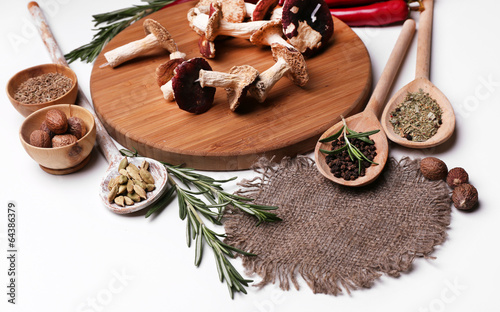 Tuinposter Kruiden 2 Different spices and cutting board, isolated on white