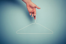 Hand Holding Wire Hanger