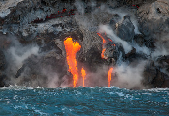 Red hot lava flowing into Pacific Ocean on Big Island, Hawaii