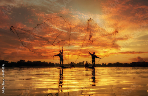Fotografia, Obraz Fisherman of Lake in action when fishing, Thailand