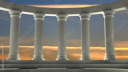 In de dag Bedehuis Ancient marble pillars in elliptical arrangement with orange sky