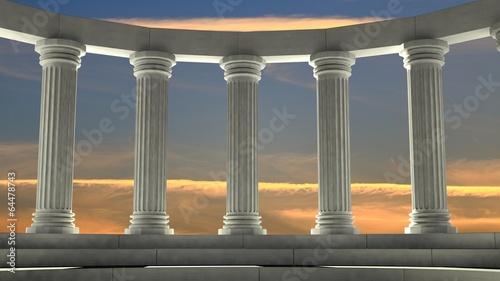 Obraz na plátne Ancient marble pillars in elliptical arrangement with orange sky