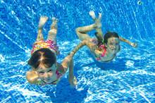 Happy Girls Swim Underwater In Pool And Having Fun