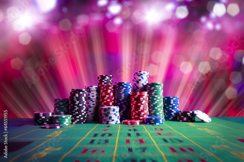 Photo  Casino chips with dramatic lighting and lens flares