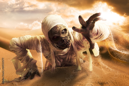 Stampa su Tela Scary mummy in a desert at sunset