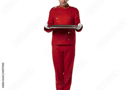 Fotografie, Obraz  Red suit bellboy with tray isolated on white