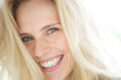 Leinwanddruck Bild - Cheerful young blond woman smiling
