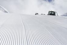 Fresh Snow Groomer Tracks On A...